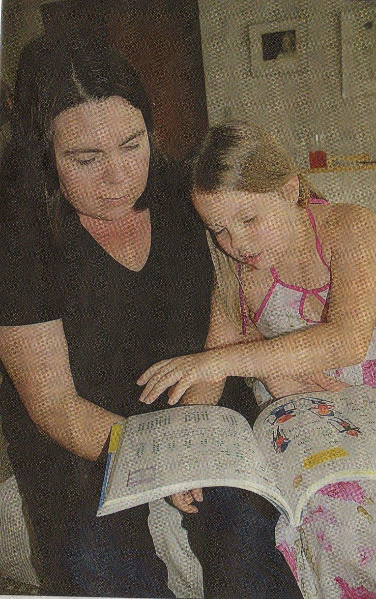 Riika Pahka does math drills with her daughter Aura