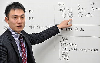 More and more Japanese parents and students are thinking the same way, said Mr Masanori Fujii (left), of the cram school company Benesse Corp, which offers customised 'Route H' courses at an average of 2.5 million yen (S$37,427). -- PHOTO: AFP