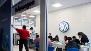 Giving kids a run for their money: Students from a middle school in Fairfax, Virginia, participate in a financial-literacy program that includes exercises on mortgages, paying bills and applying for credit. Here, they gather in the Volkswagen storefront for information on car-buying. | THE WASHINGTON POST