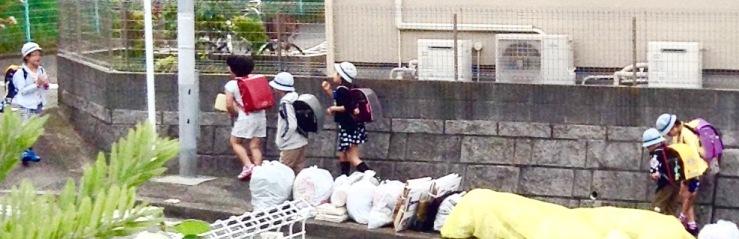 Elementary school kids make their way back to school at the end of the Golden Week short schoolbreak